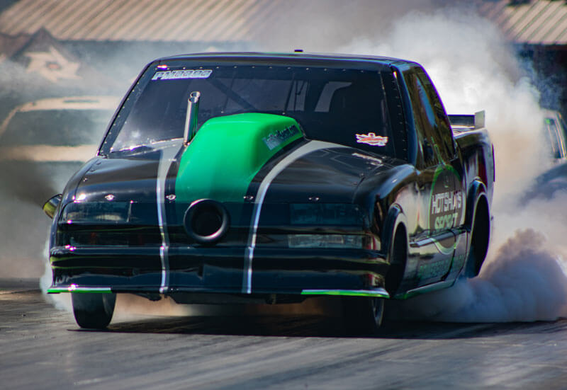 Hot Shot's Secret Firepunk S10 truck in action during a drag race.